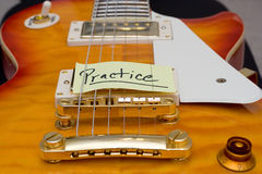 Guitar Practice. A Les Paul style electric guitar with a note saying Practice Stock Photo