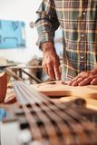 Guitar production in luthier`s workshop Stock Photo