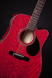 Guitar Red Acoustic Isolated on Black Royalty Free Stock Image