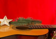 Guitar red backround for christmas text Stock Photos