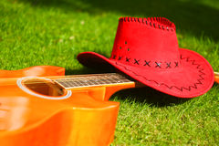 Guitar and red hat Stock Image