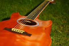 Guitar and red hat Stock Photography