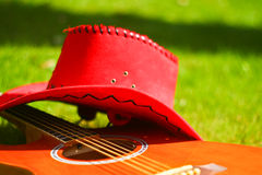 Guitar and red hat Stock Images