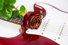 Guitar with red rose. Music, romantic, sound Stock Photography