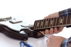 Guitar repairing Royalty Free Stock Photography