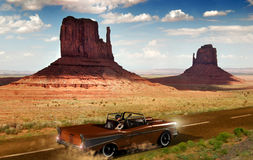 Guitar on the road. A road of  Monument Valley, in Utah Royalty Free Stock Photo