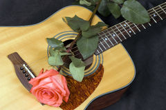 Guitar and rose Royalty Free Stock Images