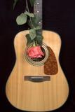 Guitar and rose