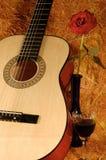 Guitar, rose, wine