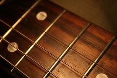 Guitar's Fingerboard. A macro shot of guitar's fingerboard and strings Stock Photos