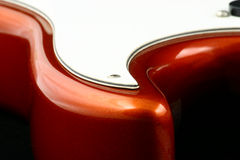 Guitar's rounds. Body fragment of a shine red electric guitar Stock Photography