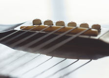 Guitar saddle Stock Images