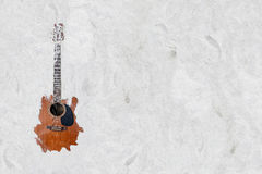The guitar in the sand on the beach. The guitar embed in the sand on the beach Royalty Free Stock Images