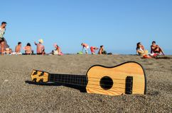 Guitar on the Sand Beach. Photo Picture of a Guitar on the Sand Beach Royalty Free Stock Photo