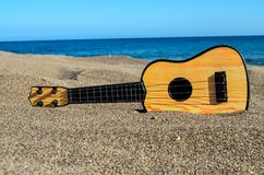 Guitar on the Sand Beach. Photo Picture of a Guitar on the Sand Beach Stock Images