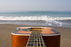 Guitar and sea Royalty Free Stock Image