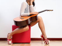 Guitar and legs royalty free stock images
