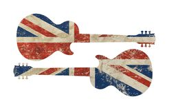 Guitar shaped grunge vintage UK Great Britain flag. Two guitars shaped old grunge vintage dirty faded shabby distressed UK Great Britain national flag isolated Royalty Free Stock Photos