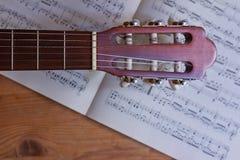 Guitar, sheet music. Acoustic guitar, instrument,  close up, sheet music Stock Photos