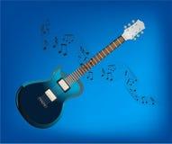 Guitar and sheet music Stock Photo