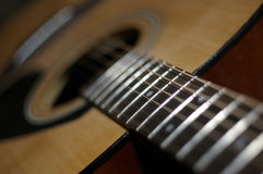 Guitar. Six-stringed wooden guitar without a mediator Royalty Free Stock Images