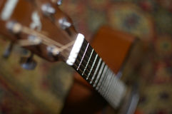 Guitar six-stringed. Six-stringed wooden guitar without a mediator Stock Photography