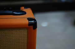 A guitar speaker with selective focus and blurry background. Music stock photography