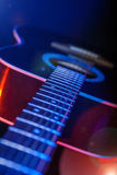 Guitar in the spotlight Royalty Free Stock Photography