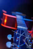 Guitar in the spotlight Stock Images