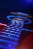 Guitar in the spotlight Stock Photo