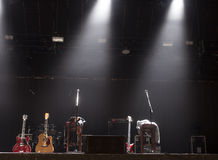 Guitar  on stage before concert. Guitar and other musical equipment on stage before concert Royalty Free Stock Images