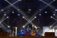 Guitar  on stage before concert. Guitar and other musical equipment on stage before concert Royalty Free Stock Photos