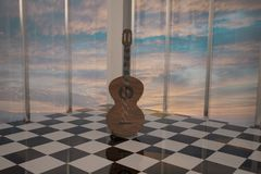 Guitar standing in elegant room Royalty Free Stock Images