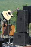 Guitar and stereo speakers. Royalty Free Stock Images