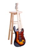 Guitar And Stool Royalty Free Stock Photography