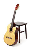 Guitar and stool Stock Photography