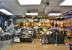 Guitar store full of guitars. Bags, and accessories Stock Photo