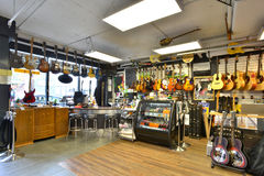 Guitar store full of guitars Stock Photography