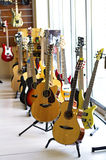 Guitar store. Guitars in guitar store, electric and acoustic bass Royalty Free Stock Photos