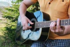 Guitar string man hand outdoor Royalty Free Stock Photos