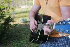 Guitar string man hand outdoor Stock Photography