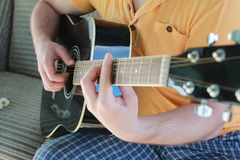Guitar string man hand outdoor Stock Images