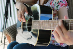 Guitar string woman hand outdoor Stock Image