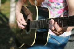 Guitar string woman hand outdoor Royalty Free Stock Images
