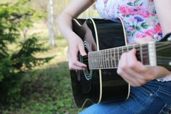 Guitar string woman hand outdoor Stock Images