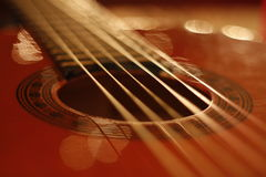 Guitar strings. Low light macro picture of guitar with lights reflections Royalty Free Stock Photos