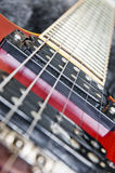 Guitar and strings. Close up on guitar strings and pick-up Royalty Free Stock Photo