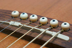 Guitar strings. A close up of a guitar string on a guitar Stock Image