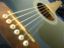 Guitar strings. Close-up blue guitar strings Royalty Free Stock Photography