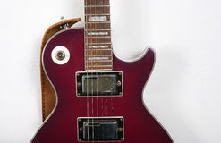 Guitar and strings. Red electro guitar and strings Royalty Free Stock Photography